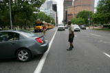 John Stewart (cq) a vehicle control agent helps a car who turned  onto Broadway the wrong...