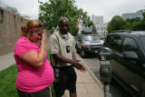 John Stewart (cq) educates Kelli McDonald (cq) of Denver about parking too far in front of a...