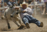 DM3367  Whoa! Kelly Masters of Erie, Colo. puts the brakes on as he takes down a steer during the...