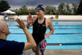 Melissa Stockwell (cq) high-fives teammate Dave Denniston (cq)  after a swim meet at Lowry Pool. ...