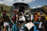 Attendees of YMCA Camp Chief Ouray near Rocky Mountain National Park unload their gear from a...