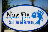 A sign for Blue Fin sushi bar is posted on the front door entrance on June 13, 2008, when Eat...
