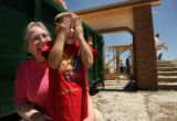 MJM103   Neighbor, Jan Whitney (cq) comforts, Ryan Zrubek, 5, as he covers his face as he watches...