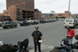 Lt. Ronald Saunier (cq) delivers a press conference at 18th and Market streets in LoDo.  Lt....