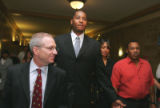 Denver Nugget player Carmelo Anthony (cq) ,center,  along with his fiancee' LaLa Vasquez, right,...
