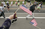 Elizabeth Peach (cq), holding left flag, and Joy Jensen (cq), holding right flag, both of Boulder,...
