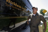 (259)  UPS driver Tim Hernandez makes his delivery stop on his regular route around Broomfield,...