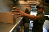 (238)  UPS driver Tim Hernandez makes his delivery stop on his regular route around Broomfield,...