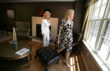 Realtor Diane Huttner takes Debi Tepper on a tour in living room with a mountain view at the...