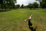 Kahmyiah Souter, 6 (cq) performs a cartwheel in City Park. During the Democratic National...