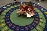 Isaiah Martin, 7, left and Cody Schier, 7, read some books,  Thursday morning, July 10, 2008,...