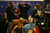 Kyle Coppage, 14, (cq) shows his exhaustion while waiting to board a Greyhound bus at 1055 19th...