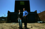 Portrait of Chris Behrens and Dave Ness, owners of Urban Thrive Real Estate, in front of the...