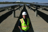 Portrait of Matthew Angell, project manager at Worldwater & Solar Technologies, in front of...
