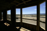New roads next to empty fields seen from a half-finished house at the Anthem development in...