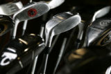 Hybrid golf clubs at Golfsmith (cq), a golf and tennis store in Englewood.   The club in the...