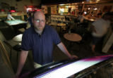 (027)  Pausing during a busy shift, Penalty Box sports bar owner Patrick Delants poses for a...
