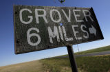 DM1894  A bullet hole pierces the center of a sign pointing the way to Grover on the northeastern...