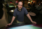 (019)  Pausing during a busy shift, Penalty Box sports bar owner Patrick Delants poses for a...