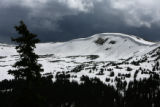 Quick moving snow showers leave a new coat of snow on the mountains, Wednesday afternoon, June 11,...