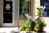 A flower display decorates the sidewalk outside of Amore Flori, a flower and gift shop, on June...
