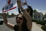 Erin Brainard (cq) chants during a protest of gas prices in front of the Shamrock gas station at...