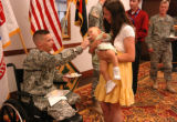 Purple Heart Awardee  SSG Joseph James gave his 10 month old daughter a taste of his cake as his...