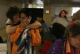 (006) Patti Montella of Art of Living Foundation comforts Jnana Nagi after a brief meditation as...