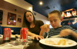 0199 Monika Fernandez, CQ, 34, and her son Damian, Fernandez, 7, enjoy a free meal at Philly's...