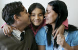 L-R  Som, Sabina and Sabitra Baral  hug in their Aurora apartment Tuesday November 25, 2008. The...