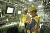 Miller plant manager Andrew Moschea and Rocky Mountain New reporter Roger Fillion tour an area...