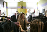 (092) Tina Call (cq), of Greeley, looks at clothes at Wild at Heart, a women's boutique clothing...