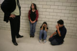Aleah Vigil, 13, (cq), Angelita Moreno, 12, (cq) and Nick Villarreal, 13, (cq) listen to assistant...