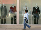 (323) A shopper walks past mannequins in a Lane Bryant storefront at Belmar Shopping Center in...
