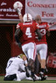 (1157) Nebraska celebrates after Cody Hawkins threw an interception taht was run back for a...