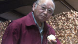 Bob Sakata (cq) after taking a bite out a yellow onion at his Sakata Farms  headquarters in...