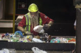james Painter (cq James Painter) removes plastic milk jugs form other recycling material for Waste...