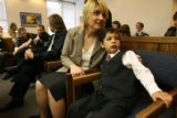 MJM006  Joshua Scott, 6, sits next to his adoptive mother, Judy Scott (cq) during the formal...