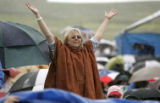 Kathleen Farfel (cq) from Denver cheers in the rain to  Arlo Guthrie who was performing at the...