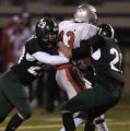 Pine Creeek High School linebacker's Chris Franquemont (#29) left, and Kenny Klein (#21) right),...