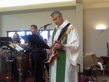 Pastor David Risendal jams with the choir between services at St. Peter Lutheran Church Greenwood...