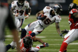 DM1318  Denver Broncos wide receiver Brandon Marshall is finally pulled down after running for...