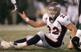 1357 Denver Broncos FB Peyton Hillis (22) questions a referee in the third quarter at Giants...