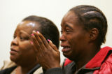 (097) A woman weeps during the first appearance of murder suspect Harry Williams at the Adams...