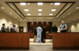 (160) Murder suspect Harry Williams is flanked by his lawyers Todd Nelson, left, and Kimberly...