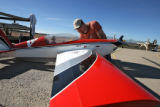 Cody Wilson (cq) gets his Comp ARF Extra 300 model airplane ready for flight, Monday afternoon,...