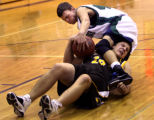 (PG161) ThunderRidge's Mike Ernst topples over Thomas Jefferson's Billy Sprague while fighting for...