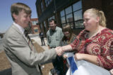Mayor John Hickenlooper shakes hands with Ingrid Hoflin (cq), 20, a current client of Urban Peaks,...