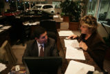 Tony Gomez, preowned manager (cq) speaks with Billie Wind, saleswoman (cq) about a car sale at...