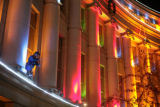 Chun Penvari (cq) checks Christmas lights on the Denver City and County building in downtown...